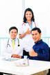 Asian Doctors with Patient in medical office or clinic