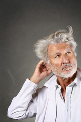 White hair scientist deeply thinking