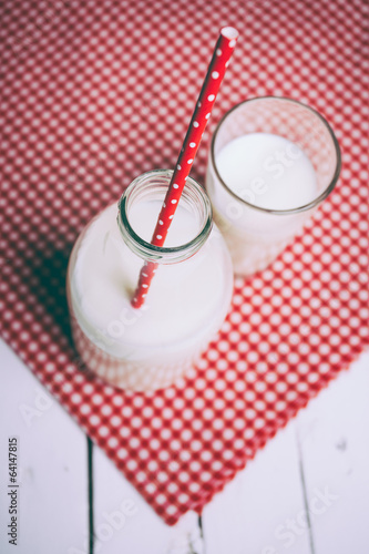 Fresh milk and glass on wooden table