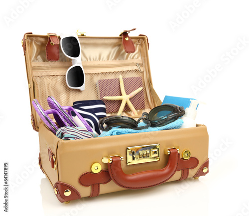 Ready to travel open suitcase with summer equipment isolated - 64147895