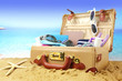 Full open suitcase on tropical beach background - 64148002