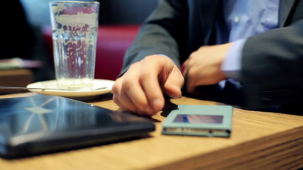 Hands of impatient businessman waiting for something in cafe