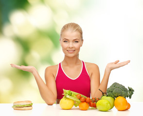 smiling woman with fruits and hamburger
