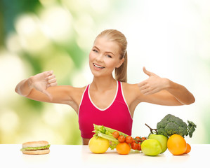 woman with fruits and hamburger comparing food