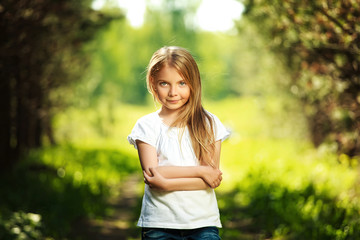 Cute young girl staying in the forest