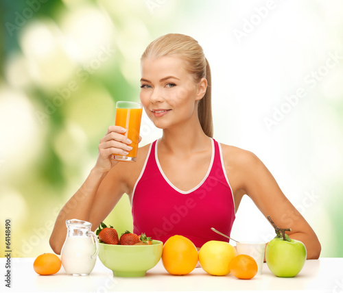 smiling young woman eating healthy breakfast