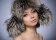 Portrait of a girl in a fur hat