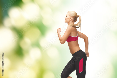sporty woman running or jumping - 64148850