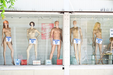 Nude Mannequins with Everything Must Go Sign