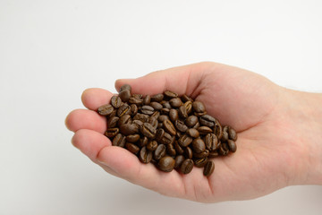 Handful of coffee beans on white background