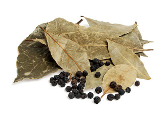 Dry bay leaves and black pepper isolated on white background