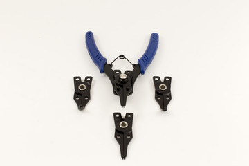 Universal snap ring pliers set on the light background