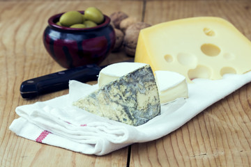 Cheese with olives and Nuts on the Table