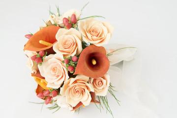 Colorful bouquet of orange calla lilies