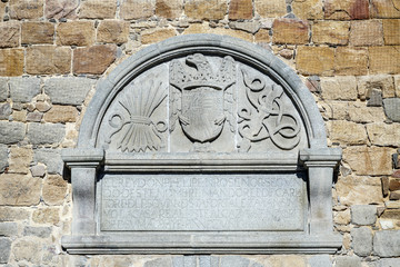 stone shield in front of the Alcazar in Avila