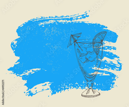Tropical cocktail with ice on blue grunge background