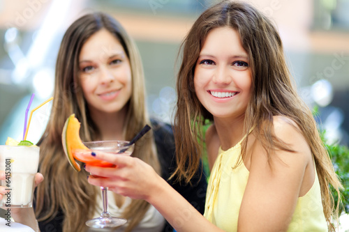 Two women having a drink