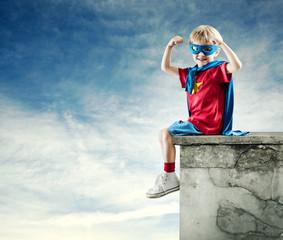 Super hero boy with raised fists