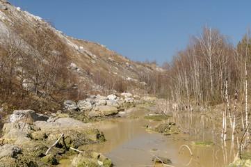 Sewage ditch along the mountainside waste limestone