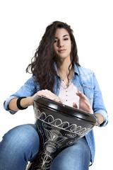 Young woman playing drum
