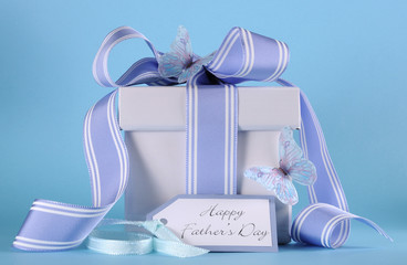 Happy Fathers Day blue gift with greeting gift tag