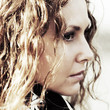Portrait of sad beautiful woman with long curly hairs