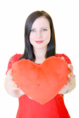 Attractive young woman red heart-shaped pillow.