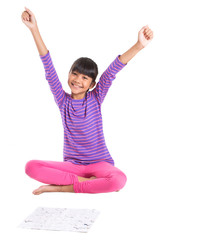 Young Asian Malay girl playing jigsaw puzzle