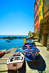 Riomaggiore village street, boats and sea. Cinque Terre, Ligury,