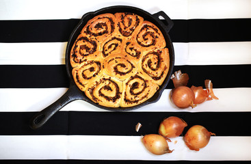Bread rolls with onion, rollled buns baked in iron cast pan