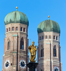 The golden sculpture of Saint Mary and the Church of Our Lady