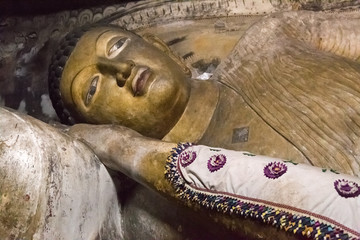 Big  golden Buddha statue inside of Dambulla cave temple