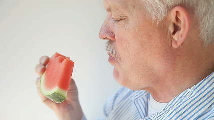 man eats watermelon slice