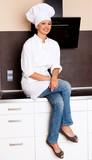 Beautiful Brunette Female Chef In Her Kitchen