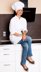 Beautiful Brunette Female Chef In Her Kitchen