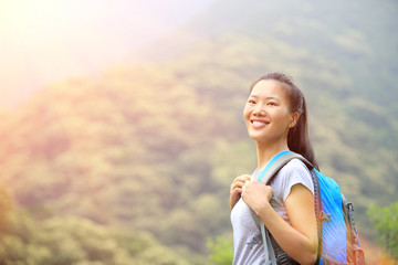 hiking woman enjoy the beautiful view at mountain peak