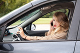 smoking woman  driving a car and speaking on the phone