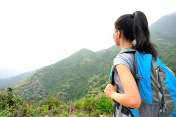 hiking woman enjoy the beautiful view at mountain peak