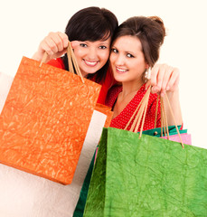 two attractive girl after shopping
