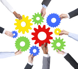 Diverse Business People Holding Cogs