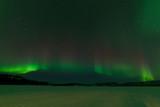 Fototapeta Nightsky Aurora borealis frozen Lake Laberge Yukon