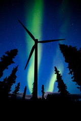Northern Lights night sky wind turbine silhouette