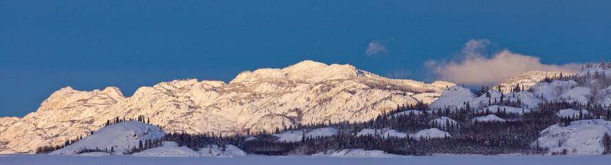 Snowy winter mountain ranges Yukon Canada panorama