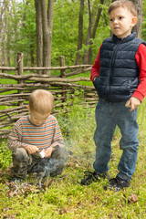 Two young boys learning survival skills