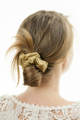 Young woman with casual messy bun hairdo