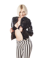 attractive blonde in a black leather jacket posing on a white