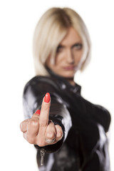 short haired blonde showing middle finger