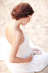 beautiful young pregnant woman in the summer beach