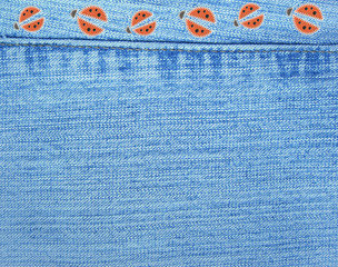 Jeans background with ladybugs