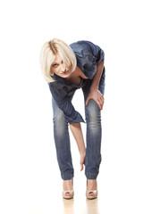 sexy blonde adjust her high heels